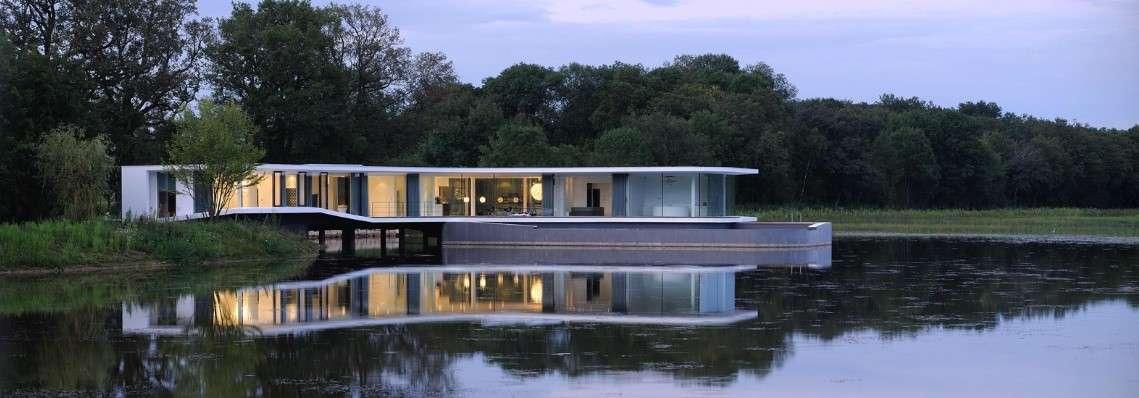 snake house on lake Modern House