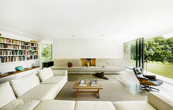 stone wall glass house interior